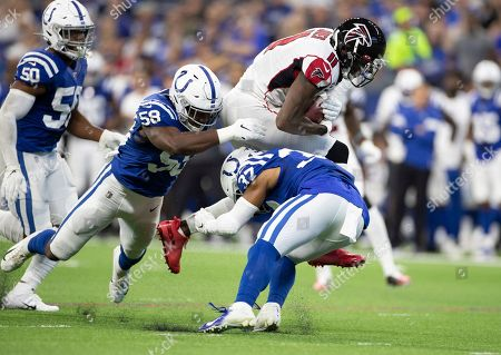 Atlanta Falcons wide receiver Julio Jones (11) runs with the ball after the catch as Indianapolis Colts safety Khari Willis (37) and Indianapolis Colts inside linebacker Bobby Okereke (58) pursue during NFL football game action between the Atlanta Falcons and the Indianapolis Colts at Lucas Oil Stadium in Indianapolis, Indiana. Indianapolis defeated Atlanta 27-24