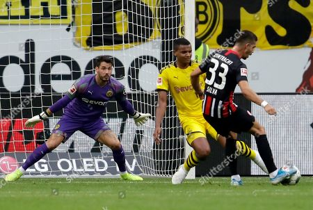 Dortmund's goalkeeper Roman Burki, left, looks on as Frankfurt's Andre Silva, right, scores his side's first goal during the Bundesliga soccer match between Eintracht Frankfurt and Borussia Dortmund in the Commerzbank Arena in Frankfurt, Germany, Sunday, Sept.22, 2019
