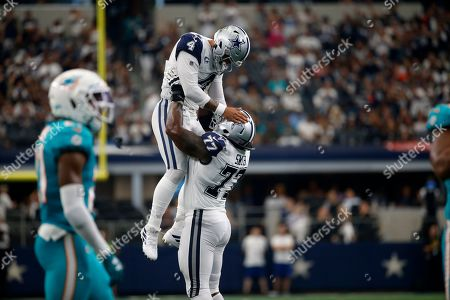 Dak Prescott, Tyron Smith. Dallas Cowboys quarterback Dak Prescott (4) is lifted in the air by offensive tackle Tyron Smith (77) after throwing a touchdown pass to wide receiver Amari Cooper (19) in the second half of a NFL football game against the Miami Dolphins in Arlington, Texas