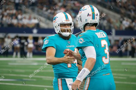 Ryan Fitzpatrick;Josh Rosen. Miami Dolphins quarterback Ryan Fitzpatrick (14) and Miami Dolphins quarterback Josh Rosen (3) shake hands while playing against the Dallas Cowboys in the first half of a NFL football game in Arlington, Texas