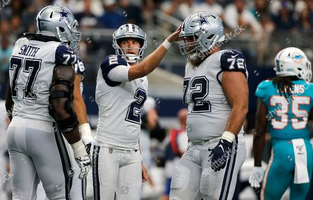 Brett Maher ;Tyron Smith; Travis Frederick. Dallas Cowboys place kicker Brett Maher (2) celebrates with teammates offensive tackle Tyron Smith (77) and center Travis Frederick (72) against the Miami Dolphins during the second half of a NFL football game in Arlington, Texas