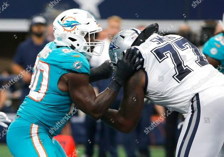 Charles Harris;Tyron Smith. Miami Dolphins defensive end Charles Harris (90) takes on Dallas Cowboys offensive tackle Tyron Smith (77) during the second half of a NFL football game in Arlington, Texas