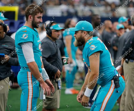 Ryan Fitzpatrick, Josh Rosen. Miami Dolphins' Josh Rosen (3) talks with quarterback Ryan Fitzpatrick (14) on the sideline in the first half of a NFL football game against the Dallas Cowboys in Arlington, Texas