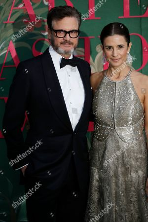 Colin Firth, Livia Giuggioli. Colin Firth, left, and Livia Giuggioli pose for photographers upon arrival at the Green Carpet Fashion Awards in Milan, Italy