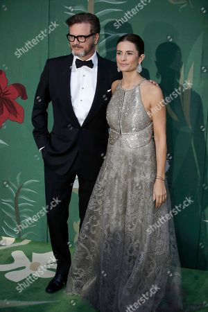 Stock Picture of Colin Firth, Livia Giuggioli. Colin Firth, left, and Livia Giuggioli pose for photographers upon arrival at the Green Carpet Fashion Awards in Milan, Italy