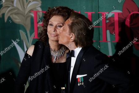 Sophia Loren, Valentino Garavani. Designer Valentino Garavani, right, kisses actress Sophia Loren upon arrival at the Green Carpet Fashion Awards in Milan, Italy