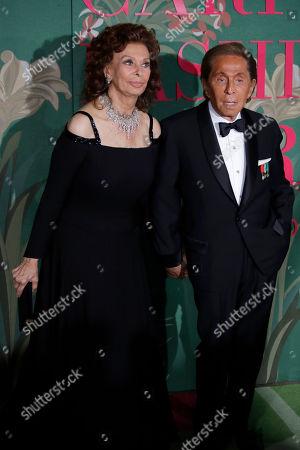 Sophia Loren, Valentino Garavani. Designer Valentino Garavani, right, and actress Sophia Loren pose for photographers upon arrival at the Green Carpet Fashion Awards in Milan, Italy