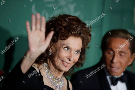 Sophia Loren, Valentino Garavani. Actress Sophia Loren, left, and designer Valentino Garavani pose for photographers upon arrival at the Green Carpet Fashion Awards in Milan, Italy