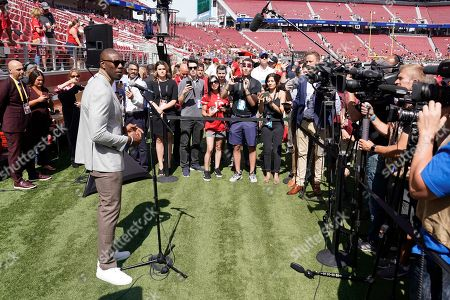 Former San Francisco 49ers wide receiver Terrell Owens speaks to reporters before an NFL football game between the 49ers and the Pittsburgh Steelers in Santa Clara, Calif