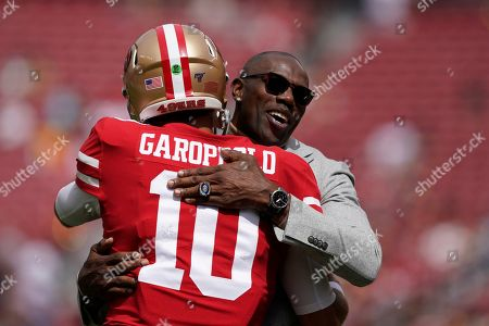 Stock Picture of Former San Francisco 49ers wide receiver Terrell Owens, right, hugs 49ers quarterback Jimmy Garoppolo (10) before an NFL football game between the 49ers and the Pittsburgh Steelers in Santa Clara, Calif