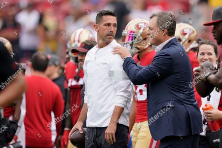 San Francisco 49ers head coach Kyle Shanahan, left, talks with general manager John Lynch before an NFL football game against the Pittsburgh Steelers in Santa Clara, Calif