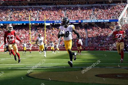 Stock Image of Pittsburgh Steelers wide receiver Diontae Johnson, center, scores a touchdown in front of San Francisco 49ers defensive back Jason Verrett (27) during the second half of an NFL football game in Santa Clara, Calif