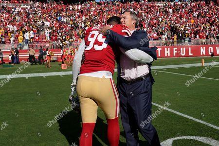 San Francisco 49ers defensive tackle DeForest Buckner (99) hugs general manager John Lynch after an NFL football game against the Pittsburgh Steelers in Santa Clara, Calif