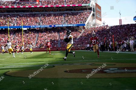 Pittsburgh Steelers wide receiver Diontae Johnson, center, catches a touchdown in front of San Francisco 49ers defensive back Jason Verrett (27) during the second half of an NFL football game in Santa Clara, Calif