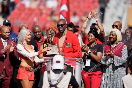 Former San Francisco 49ers wide receiver Terrell Owens is honored during a ceremony as he is inducted into the team's Hall of Fame during halftime of an NFL football game between the 49ers and the Pittsburgh Steelers in Santa Clara, Calif
