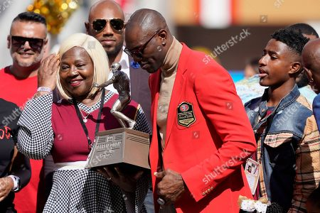 Stock Image of Former San Francisco 49ers wide receivers Terrell Owens, center right, is shown with family members during a ceremony honoring his induction into the team's during Hall of Fame halftime of an NFL football game between the 49ers and the Pittsburgh Steelers in Santa Clara, Calif