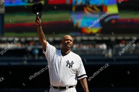 New York Yankees' CC Sabathia waves to fans as he is honored before a baseball game against the Toronto Blue Jays, in New York