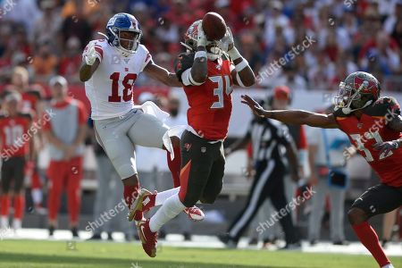 Tampa Bay Buccaneers safety Mike Edwards (34) breaks up a pass intended for New York Giants wide receiver Bennie Fowler (18) during the first half of an NFL football game, in Tampa, Fla