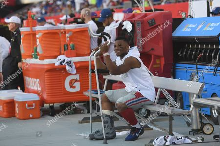 New York Giants running back Saquon Barkley on the bench against the Tampa Bay Buccaneers during the second half of an NFL football game, in Tampa, Fla
