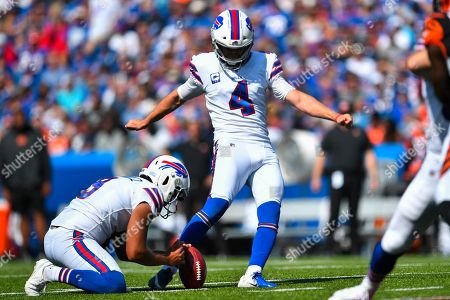 Buffalo Bills' Stephen Hauschka (4) kicks a field goal during the first half of an NFL football game against the Cincinnati Bengals, in Orchard Park, N.Y