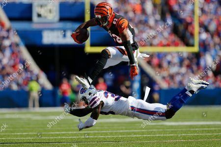 Cincinnati Bengals' Tyler Boyd (83) hurdles Buffalo Bills' Siran Neal (33) during the second half of an NFL football game, in Orchard Park, N.Y