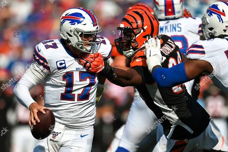 Cincinnati Bengals defensive end Carlos Dunlap (96) reaches for Buffalo Bills quarterback Josh Allen (17) during the second half of an NFL football game, in Orchard Park, N.Y