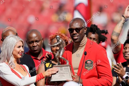 Stock Photo of Former San Francisco 49ers wide receiver Terrell Owens is honored during a ceremony as he is inducted into the team's Hall of Fame during halftime of an NFL football game between the 49ers and the Pittsburgh Steelers in Santa Clara, Calif