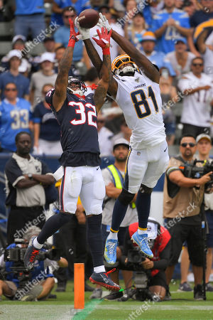 Houston Texans cornerback Lonnie Johnson, left, breaks up a pass intended for Los Angeles Chargers wide receiver Mike Williams during the first half of an NFL football game, in Carson, Calif