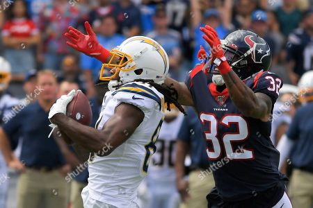 Los Angeles Chargers wide receiver Mike Williams, left, catches a pass in front of Houston Texans cornerback Lonnie Johnson during the first half of an NFL football game, in Carson, Calif