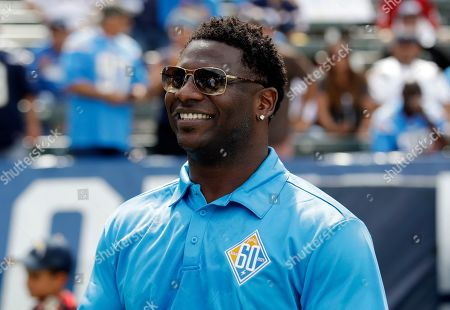 Stock Picture of Former Los Angeles Chargers player LaDainian Tomlinson smiles on the sidelines during an NFL football game against the Houston Texans in Carson, Calif