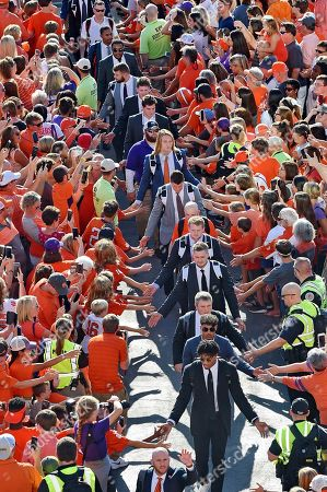 """Trevor Lawrence, Traditions. Clemson quarterback Trevor Lawrence, center, and teammates greet the fans during """"Tiger Walk"""" before the start of an NCAA college football game against Charlotte, in Clemson, S.C"""