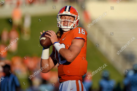 Clemson quarterback Trevor Lawrence warms up before the start of an NCAA college football game against Charlotte, in Clemson, S.C
