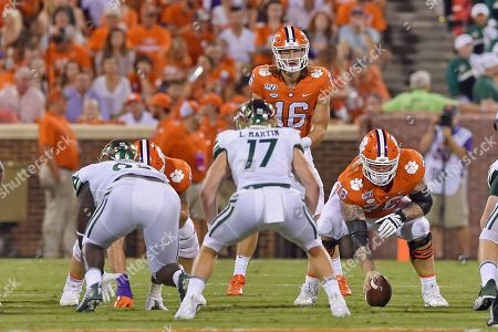 Clemson quarterback Trevor Lawrence waits on the snap during the first half of an NCAA college football game against Charlotte, in Clemson, S.C