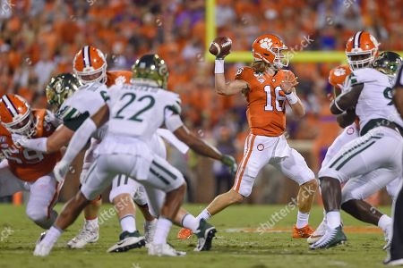 Clemson quarterback Trevor Lawrence throws a pass during the first half of an NCAA college football game against Charlotte, in Clemson, S.C