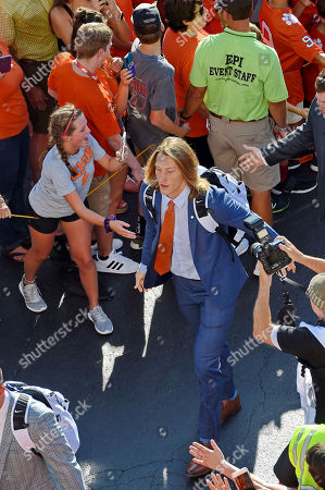 """Trevor Lawrence, Traditions. Clemson quarterback Trevor Lawrence greets the fans during """"Tiger Walk"""" before the start of an NCAA college football game against Charlotte, in Clemson, S.C"""