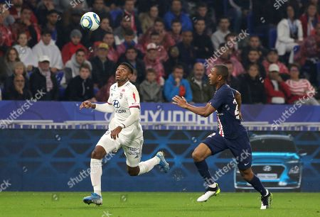 Stock Picture of Lyon's Maxwel Cornet, left looks to control the ball as PSG's Ander Herrera chases during the French League 1 soccer match between Lyon and Paris SG, at the Stade de Lyon in Decines, outside Lyon, France
