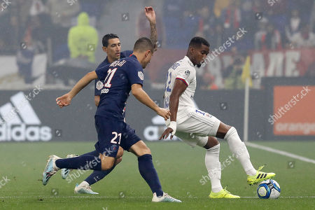 Stock Photo of Lyon's Thiago Mendes (R), Paris Saint Germain's Ander Herrera (C) and Angel Di Maria (L) in action during the French Ligue 1 soccer match between Olympique Lyon and Paris Saint Germain at Parc Olympique Lyonnais stadium in Lyon, France, 22 September 2019.