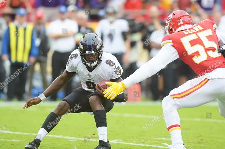 Baltimore Ravens quarterback Lamar Jackson (8) hits the brakes to avoid the tackle of Kansas City Chiefs defensive end Frank Clark (55) during the NFL Football Game between the Baltimore Ravens and the Kansas City Chiefs at Arrowhead Stadium in Kansas City, Missouri