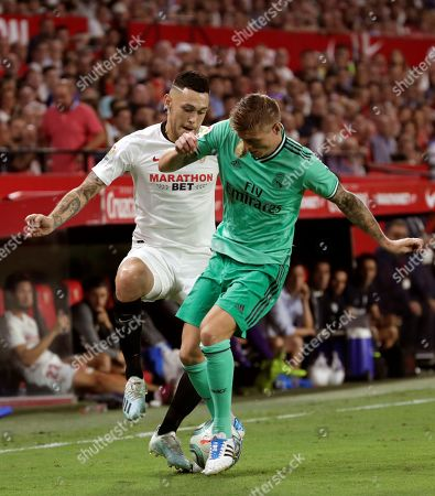 Sevilla's winger Lucas Ocampos (L) and Real Madrid's midfielder Toni Kroos (R) in action during the Spanish LaLiga match between Sevilla FC and Real Madrid CF at Ramon Sanchez Pizjuan stadium in Seville, Andalusia, Spain, 22 September 2019.