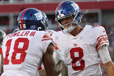 New York Giants quarterback Daniel Jones (8) and New York Giants wide receiver Bennie Fowler (18) celebrate a touchdown during the NFL game between the New York Giants and the Tampa Bay Buccaneers held at Raymond James Stadium in Tampa, Florida. Andrew J