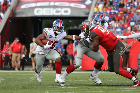 CAPTION CORRECTION ***..New York Giants running back Saquon Barkley (26) runs with the ball during the NFL game between the New York Giants and the Tampa Bay Buccaneers held at Raymond James Stadium in Tampa, Florida. Andrew J