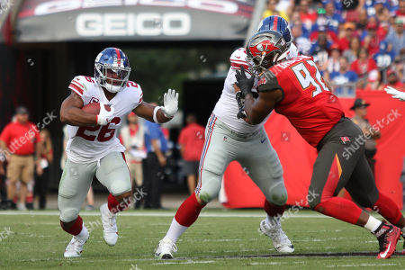 New York Giants running back Saquon Barkley (26) runs with the ball during the NFL game between the New York Giants and the Tampa Bay Buccaneers held at Raymond James Stadium in Tampa, Florida. Andrew J
