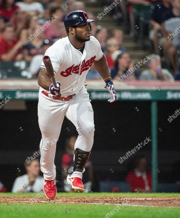 Cleveland Indians' Yasiel Puig watches his hit against the Philadelphia Phillies during a baseball game in Cleveland