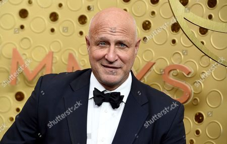 Tom Colicchio arrives at the 71st Primetime Emmy Awards, at the Microsoft Theater in Los Angeles
