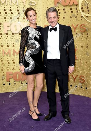 Anna Elisabet Eberstein, Hugh Grant. Anna Elisabet Eberstein, left, and Hugh Grant arrive at the 71st Primetime Emmy Awards, at the Microsoft Theater in Los Angeles