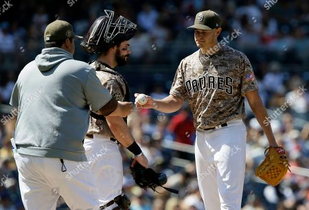 Stock Image of San Diego Padres starting pitcher Garrett Richards, right, is pulled by interim manager Rod Barajas, left, with catcher Austin Hedges watching during the second inning of a baseball game against the Arizona Diamondbacks in San Diego