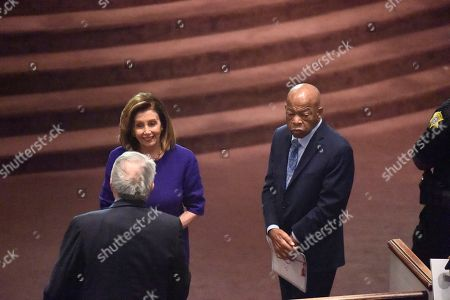Stock Picture of House Speaker Nancy Pelosi, U.S. Reps. GK Butterfield, left, and John Lewis, right, speak, at funeral services for Emily Clyburn, wife of House Majority Whip Jim Clyburn of South Carolina, in West Columbia, S.C