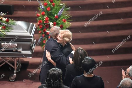 Democratic presidential contender Elizabeth Warren greets House Majority Whip Jim Clyburn at the funeral of his wife Emily, in West Columbia, S.C
