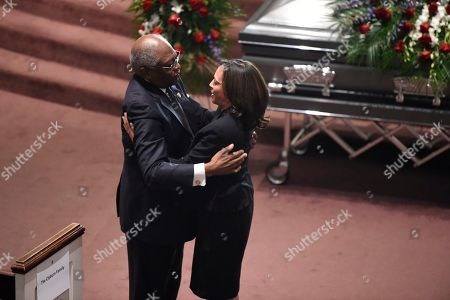 Democratic presidential contender Kamala Harris greets House Majority Whip Jim Clyburn at the funeral of his wife Emily, in West Columbia, S.C
