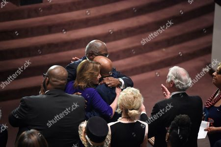 House Speaker Nancy Pelosi and U.S. Rep. John Lewis greet House Majority Whip Jim Clyburn at the funeral of Clyburn's wife, Emily,, in West Columbia, S.C